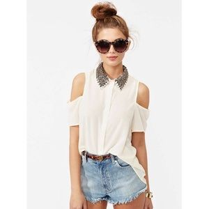 Lush top with cut-out shoulders and beaded collars